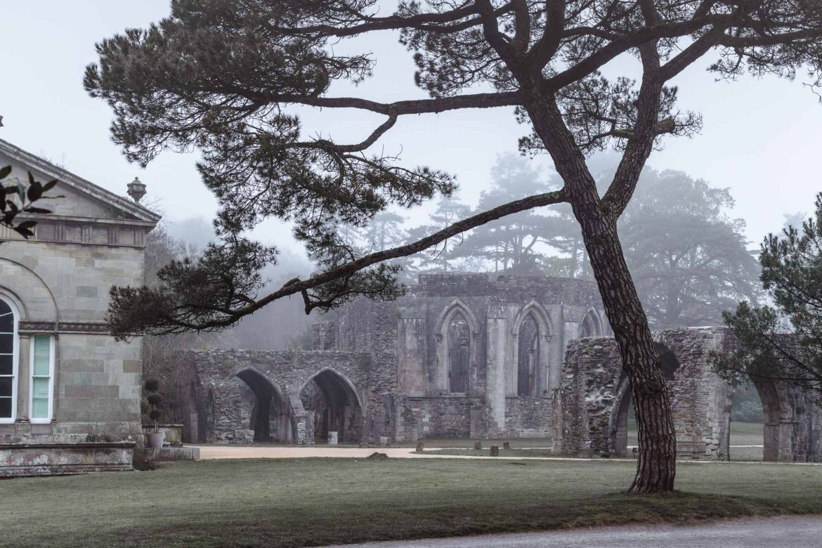 The ruins of chapter house, part of Margam Abbey at Margam Country Park, Port Talbot on a misty morning.
