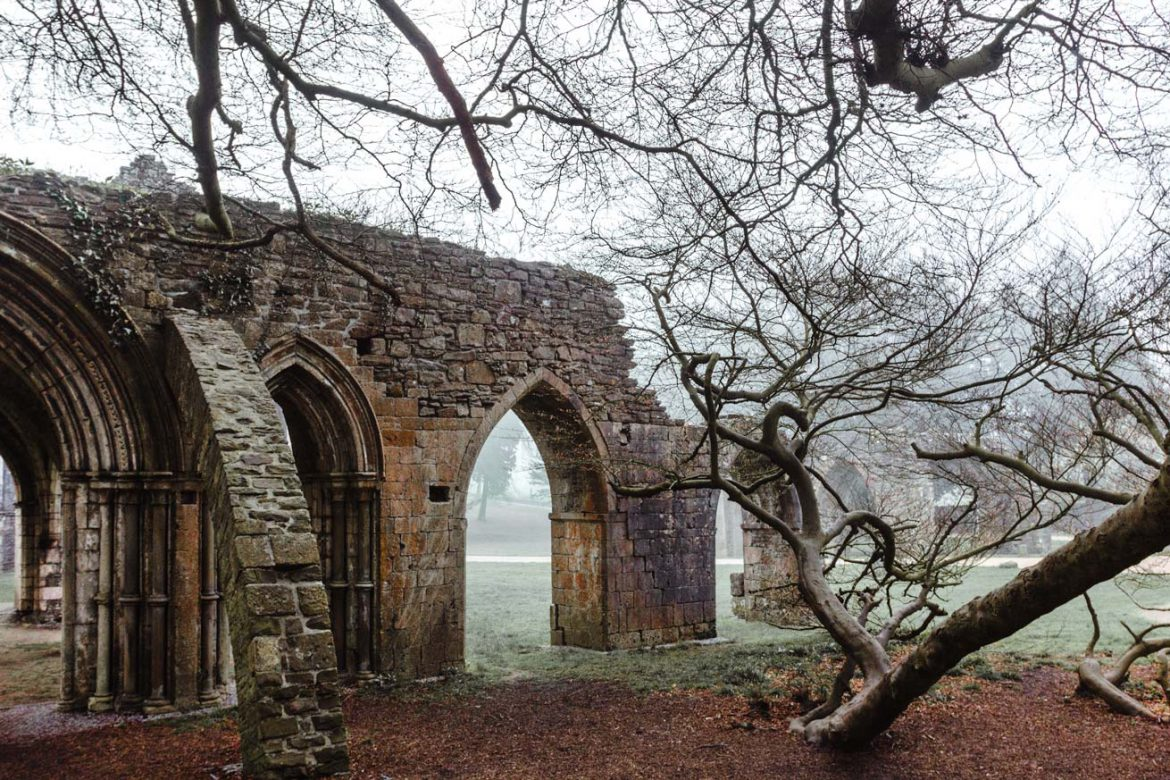 The ruins of chapter house, part of a Cistercian Abbey in Margam Abbey at Margam Country Park, Port Talbot on a misty morning.